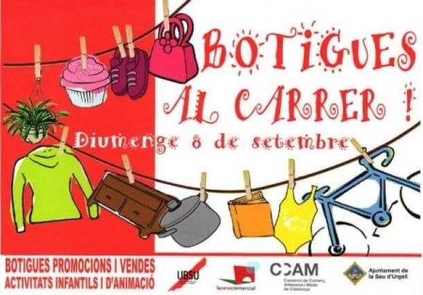 """El cartell que anuncia les """"Botigues al carrer""""."""