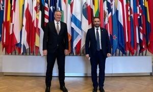 El ministre de Finances, Eric Jover, amb el secretari general de l'OCDE, Mathias Cormann.
