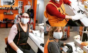 La Vero, la Carme i la Fernanda posant fil a l'agulla per fer mascaretes.