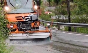 Una màquina del COEX netejant una carretera.