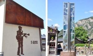 El buner ubicat a la mitgera de l'antiga plaça de mossèn Cinto, a Ordino, i l'obelisc de vitrall a la rotonda de l'Auditori.