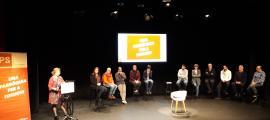 Els candidats, en l'acte d'ahir, davant d'una cadira buida: la de la ciutadania.