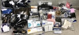 La mercaderia comissada per la policia a un home i una dona que van ser detinguts per furts en comerços.