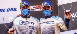 Joan Vinyes i Jaume Font van pujar al tercer esglaó del podi de Montmeló. Foto: Fotoesport